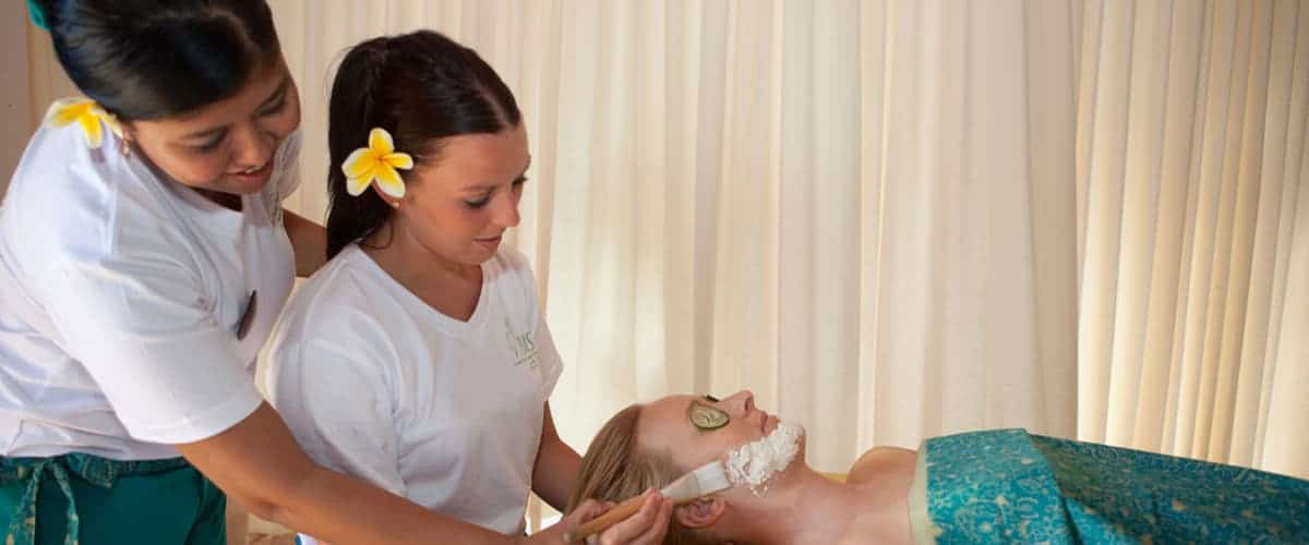 A Bali BISA trainer helping a student a traditional organic facial