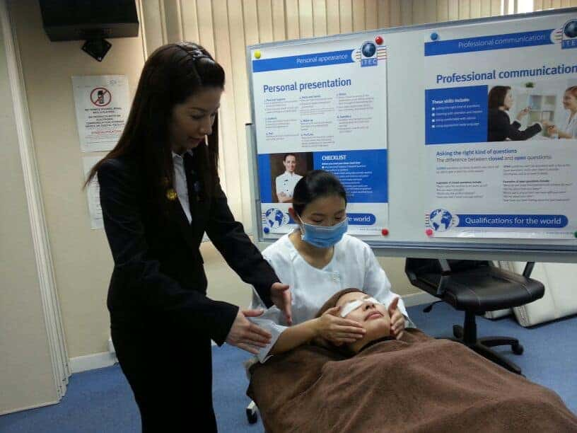 Maggie Lam training student at ITEC School in Hong Kong