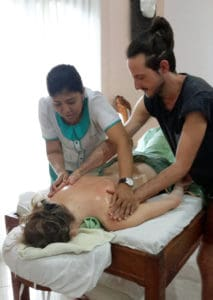 Bali BISA trainer demonstrating a massage technique