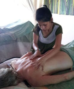 Angelina when practice her massage technique with an outside model at BISA Training Centre