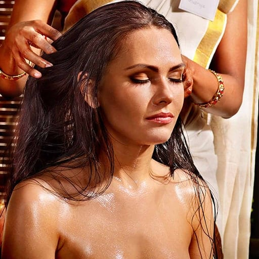 a woman having indian head massage. ITEC Indian Head Massage Award course teaches how to carry out this treatment at Bali BISA
