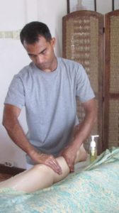 A male Spa Therapist - Prabuha learning Balinese Massage