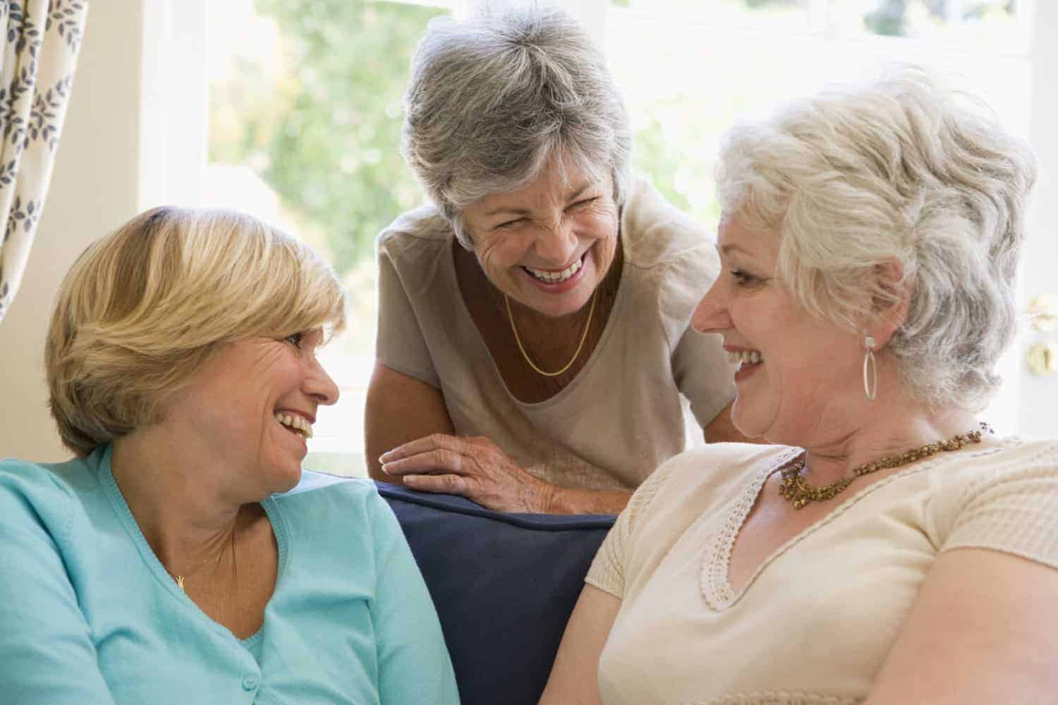 Three women are talking with each other happily